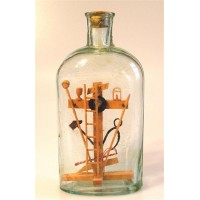 433 - 1902 Cross and Symbols in bottle